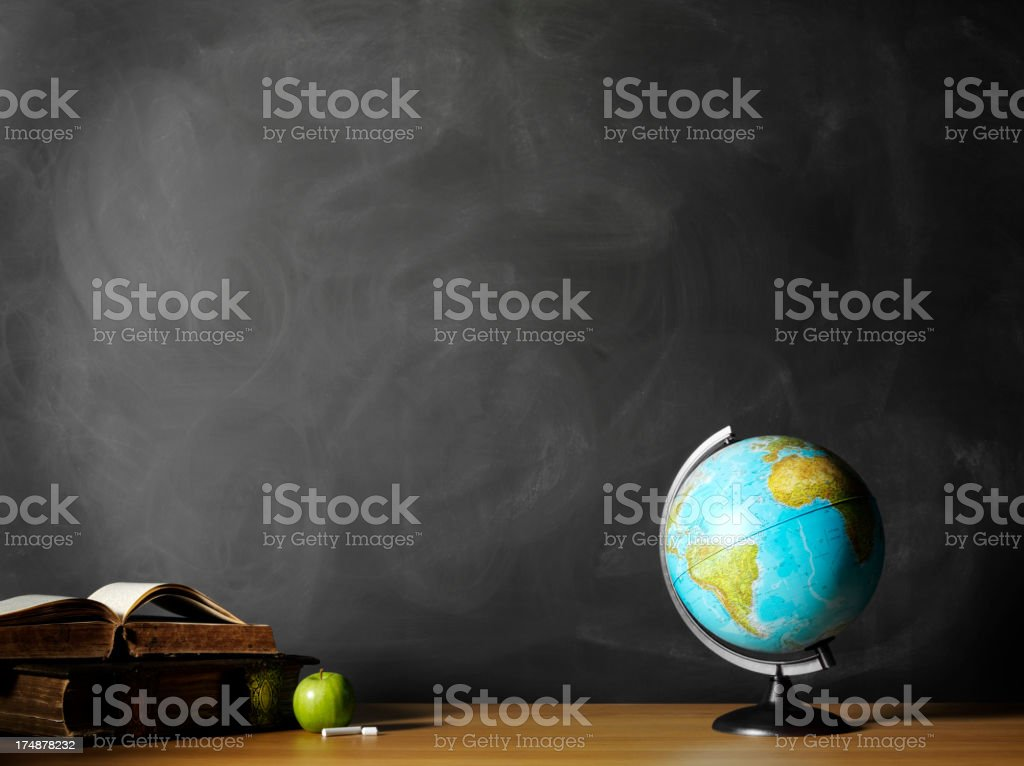 Hardback Books with a Apple and Desktop Globe stock photo