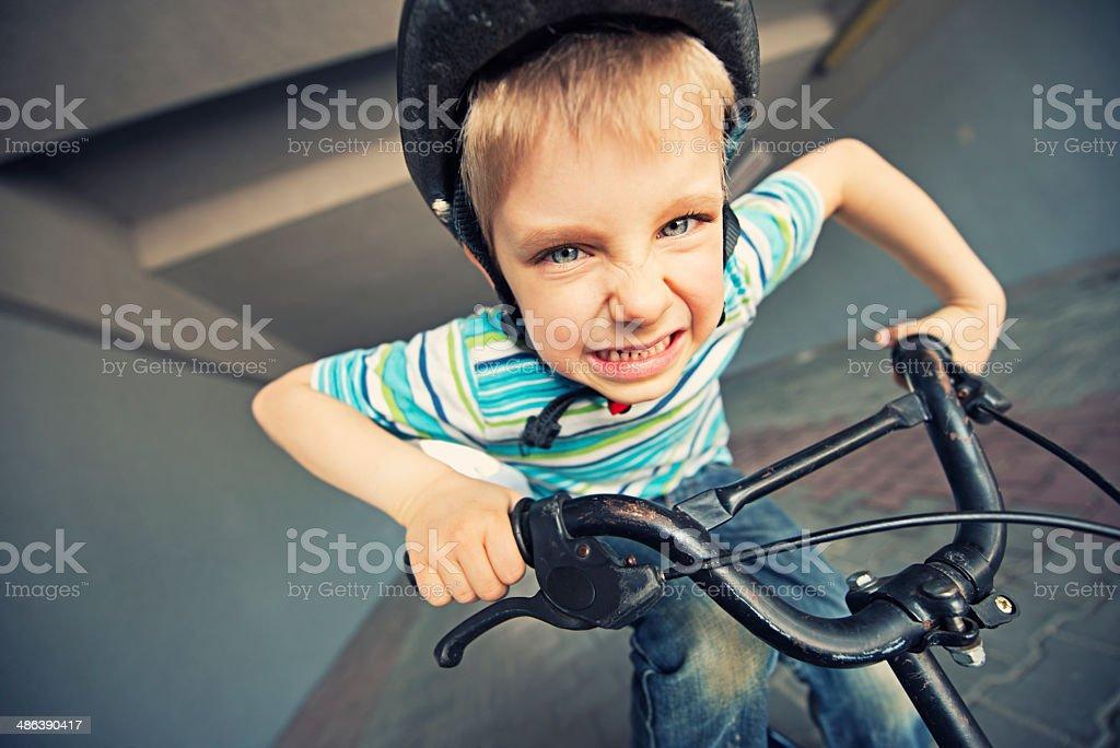 Hardcore little biker stock photo