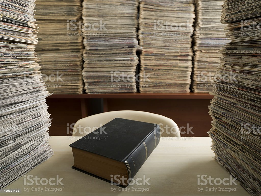 Hardcover Black Book On Desk In Newspaper Archive Library royalty-free stock photo