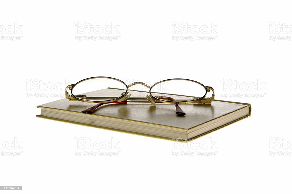 hardcover book and glasses on white background royalty-free stock photo