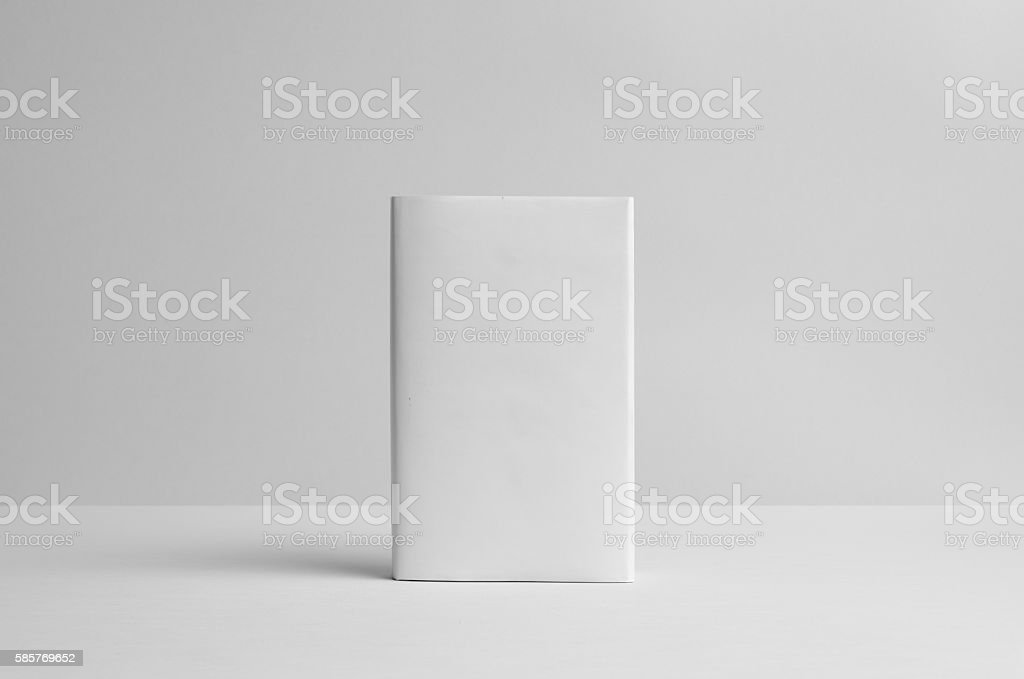 Hardcover Book Mock-Up - Dust Jacket. Front. Wall Background - Photo