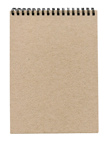Kraft notebook on a white background.  Spiral closed notebook brown paper cover