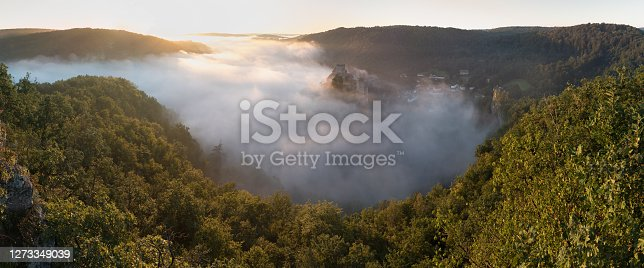 istock Hardegg medieval castle on a fortified hill upon Thaya river during summer or autumn time. Misty big ruins in the Thayatal Valley, National park, Lower Austria. The Smallest Austrian town. 1273349039