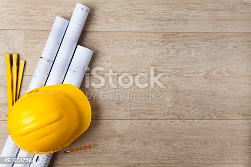istock Hardhat and blueprint 491601756