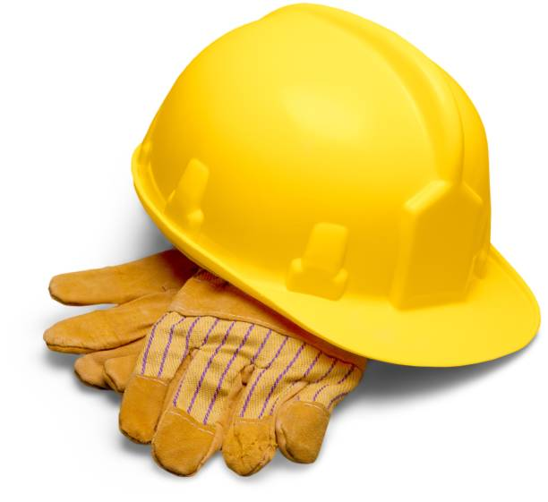 Hardhat. Yellow Safety Helmet and Safety Gloves hardhat stock pictures, royalty-free photos & images