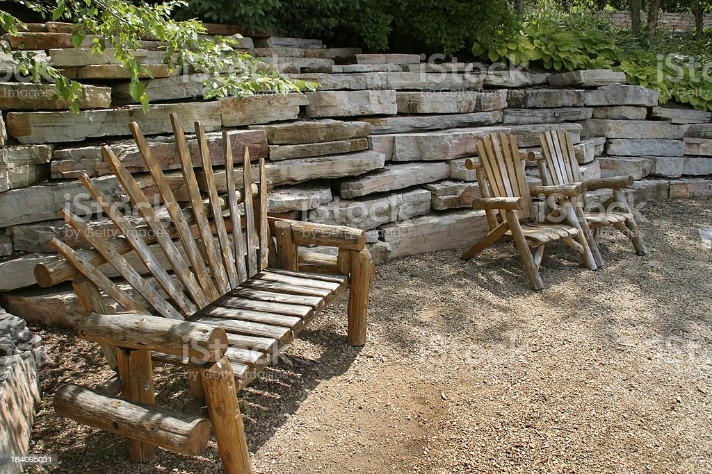 Hardscape Formal Garden Landscaping with Rock, Stone Wall, Log Benches stock photo