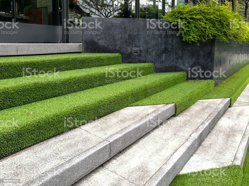 Hardscape of modern building stairway decoration with artificial grass stock photo