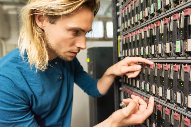 IT Hardware Administrator Checking Raid Server System stock photo