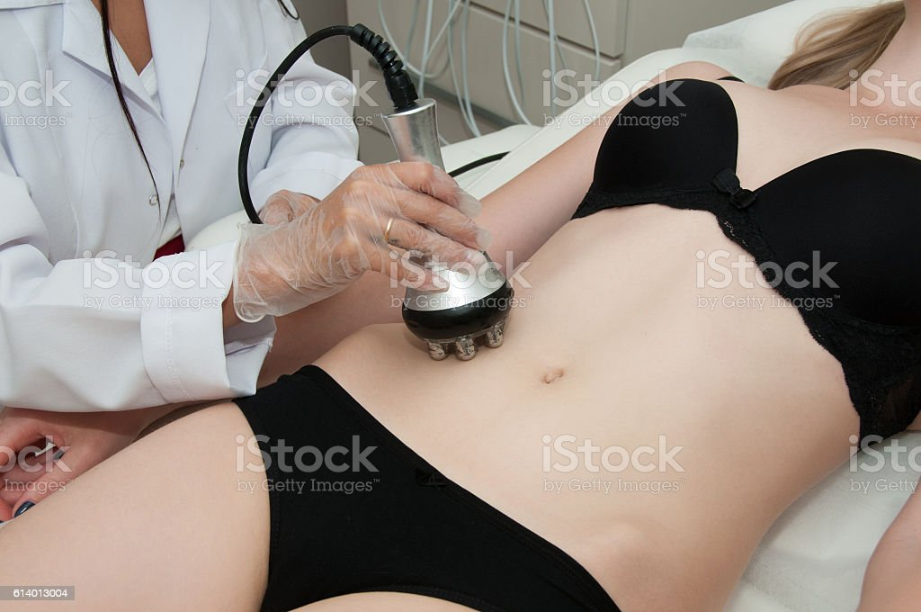 Hardware cosmetology. Young woman getting rf lifting procedure. stock photo