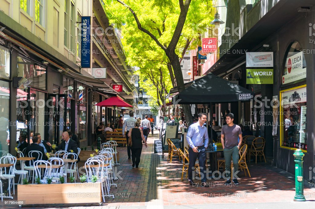 Hardware lane with outdoor cafes and restaurants stock photo