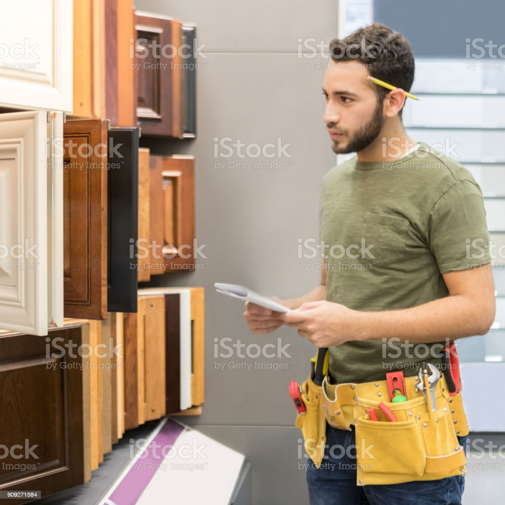 Hardware Store Employees Examines Cabinet Samples Stock Photo Download Image Now Istock