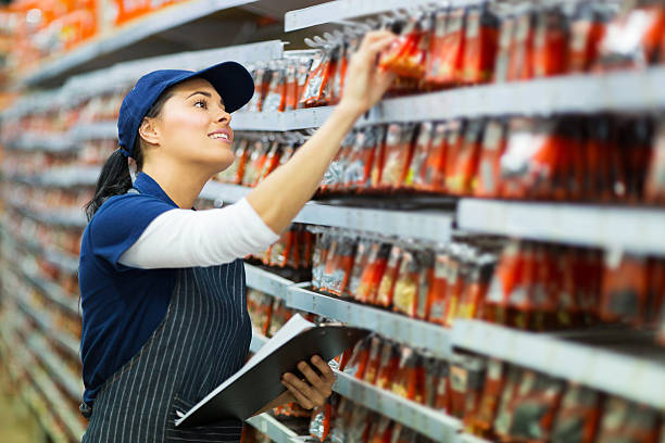 hardware store worker counting stock stock photo