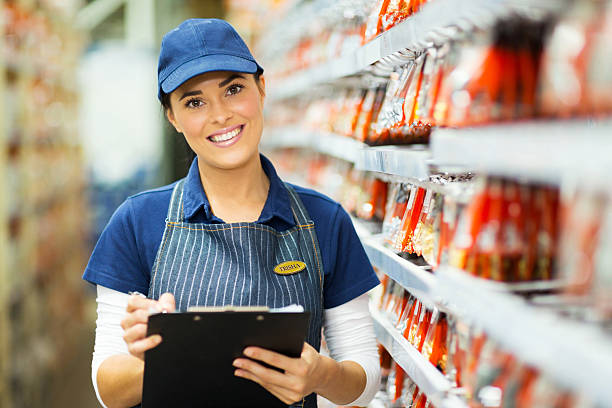 hardware store worker holding clipboard stock photo