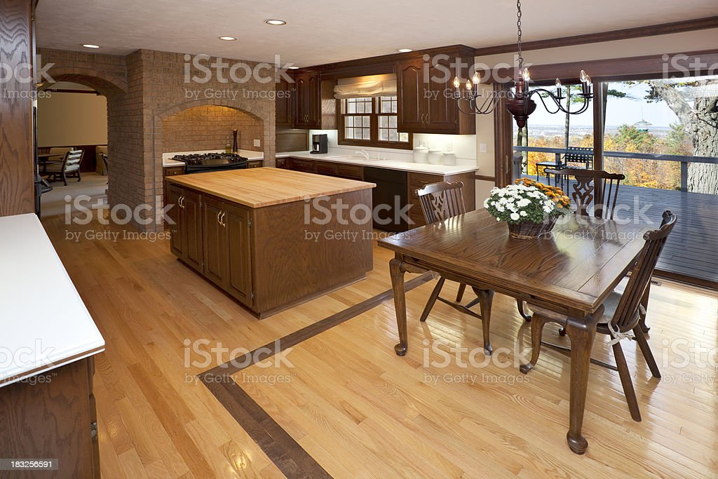 Hardwood and Brick Earth Tone Eat-In Kitchen