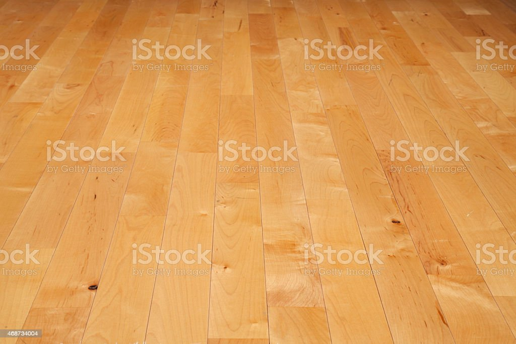 Hardwood basketball court floor viewed from a low angle stock photo