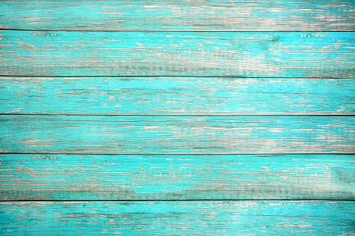 Vintage beach wood background - Old weathered wooden plank painted in turquoise or blue sea color. hardwood floor