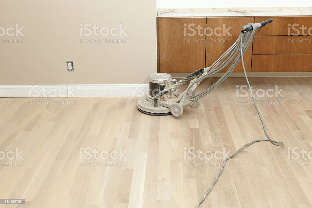 Hardwood Floor Sander on New Oak at Remodeling Project stock photo