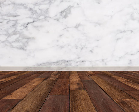 Hardwood Floor With White Marble Wall Stock Photo - Download Image Now