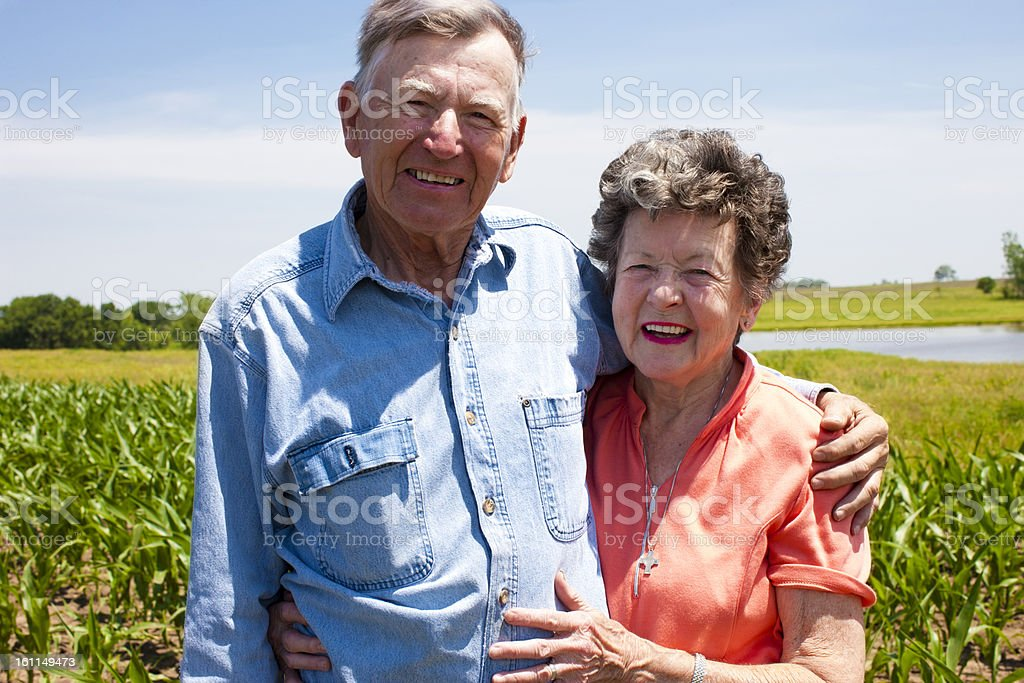 Hardworking Farm Couple Octagenarians Stand the Test of Time stock photo