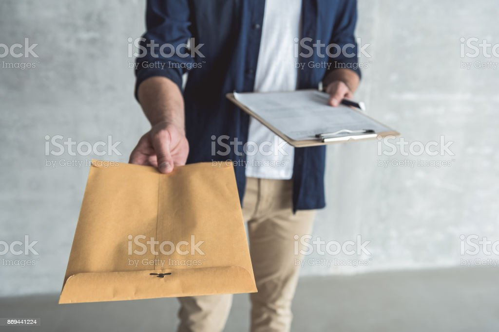 Hard-working man is carrying parcel stock photo