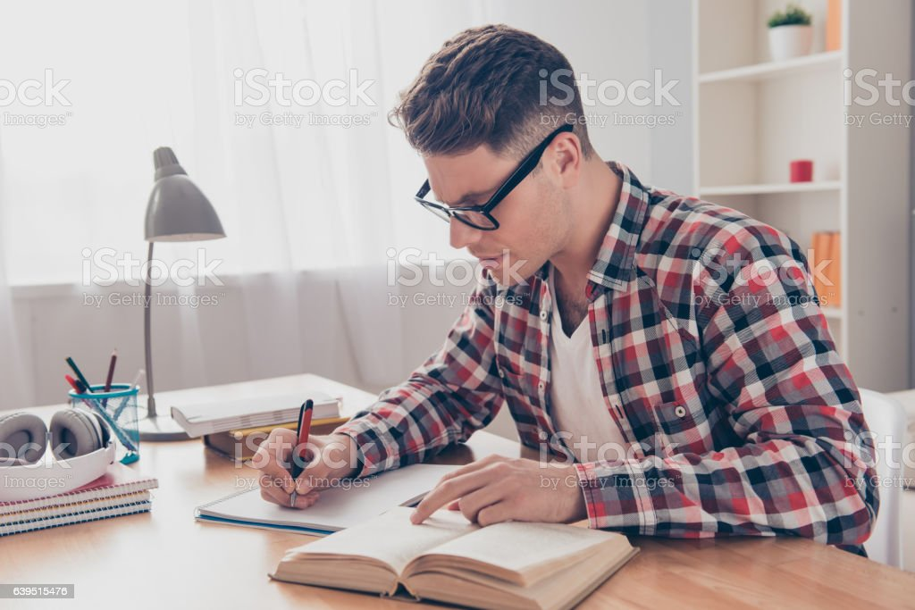 hardworking student with book preparing for test in university stock photo