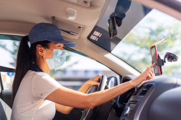 hardworking woman driving car for rideshare - side hustle stock pictures, royalty-free photos & images