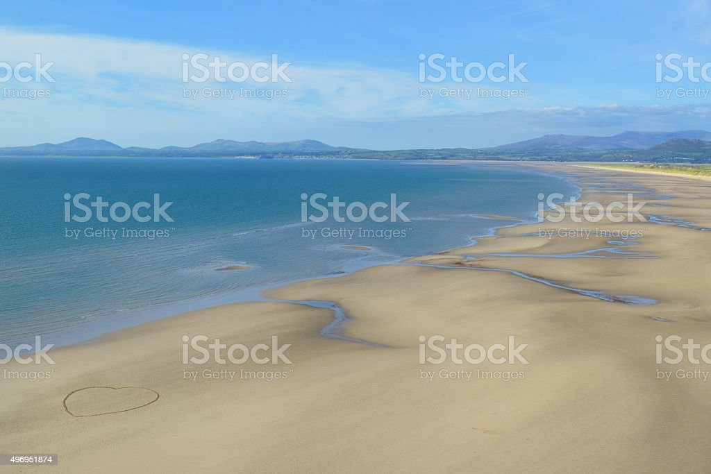 Harlech Beach with a heart stock photo