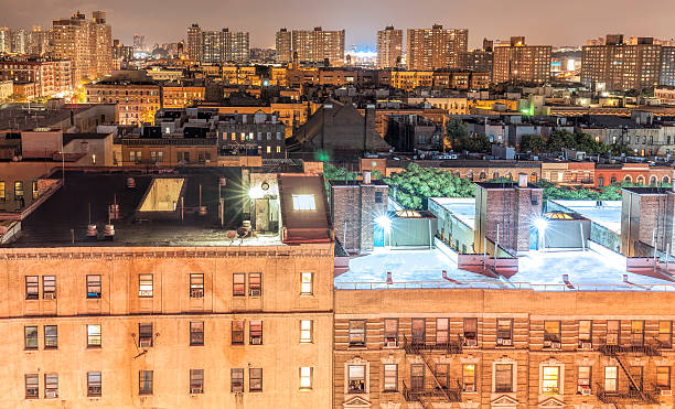 Harlem neighborhood at night, NYC, USA. stock photo