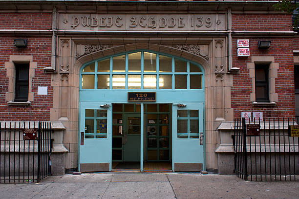 Harlem school entrance Harlem, New York City, NY, Sept. 28, 2012: Harlem public school entrance. high school building stock pictures, royalty-free photos & images