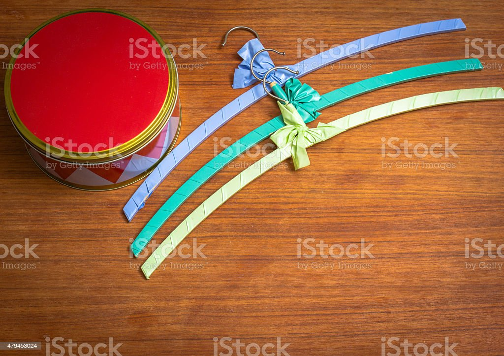 Harlequin box with colourful hangers stock photo