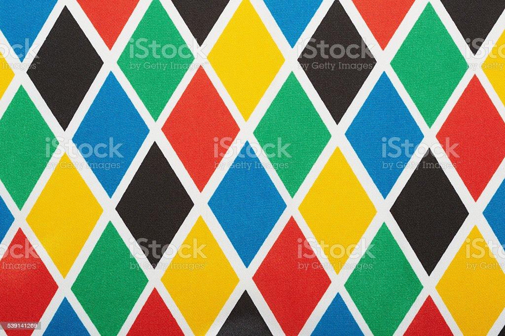 Harlequin colorful diamond pattern background stock photo