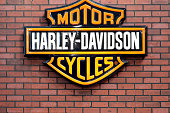 'Bucharest, Romania - April 22, 2012: Harley Davidson logo is displayed on a wall in Bucharest, Romania. Harley Davidson is an American motorcycle manufacturer.'