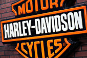 'Bucharest, Romania - April 22, 2012: Harley Davidson logo is displayed on a wall during a motorcycle exhibition in Bucharest, Romania.'