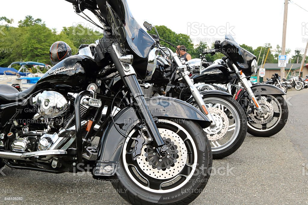 Harley Davidson's in a row parked  lakeside at biker handout stock photo