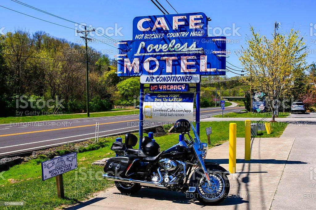 Harley motorcycyle by the Loveless Motel and Cafe, Nashville, TN Nashville, TN, USA - April 4, 2016: Harley Davidson motorcycyle parked underneath the Loveless Motel and Cafe sign on Hwy 100, Nashville, TN Above Stock Photo