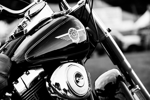 Rio das Flores (Rio de Janeiro), Brazil - April 13, 2013: Harley-Davidson on a motorcycle gas tank parking at Motorcycle Rio das Flores Annual Meeting in Brazil. Harley-Davidson Harley-Davidson, also known as H-D or Harley, is an American motorcycle manufacturer founded in Milwaukee during the early 1900. H-D sells heavyweight motorcycles well known all over the world, for their distinctive design and exhaust note.