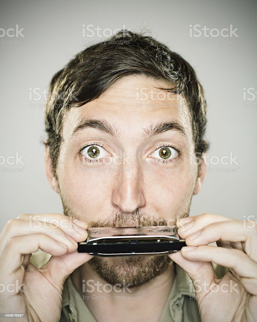Harmonica player stock photo