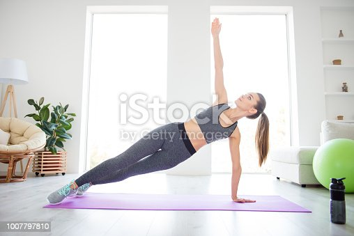 Harmony balance meditation straight  posture vitality wellness concept. Full length size photo of satisfied cheerful beautiful glad nice brunette person putting palm up to the air leaning on hand