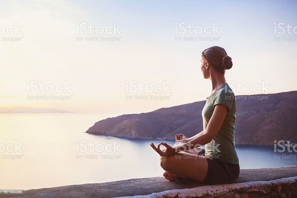 Harmony. Young woman meditating outdoors stock photo