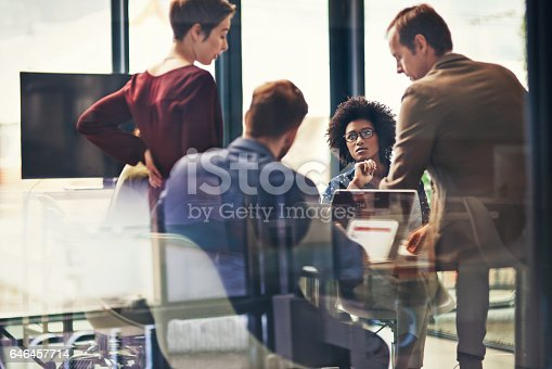Shot of a group of colleagues having a meeting at work