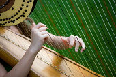 """Woman playing harp, canon 1Ds mark III"""