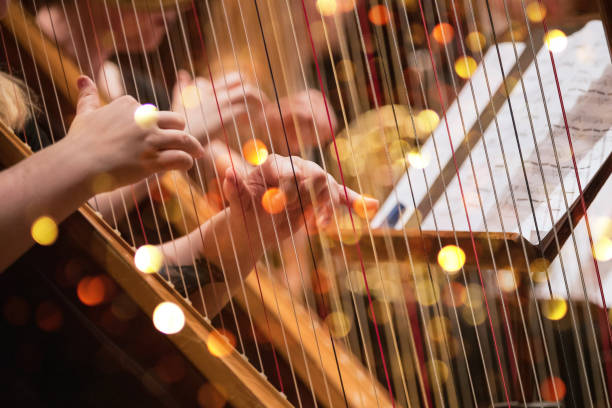 Harp player during a classical concert music stock photo