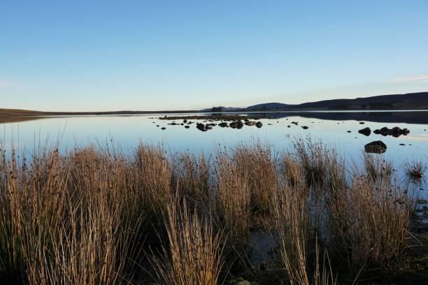 Harperrig reservoir - flat calm stock photo