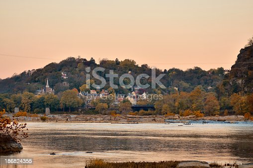 Looking up the Potomac River to the Lower Township of Harpers Ferry at dawn in the fall. This is the confluence of the Potomac and Shenandoah rivers.