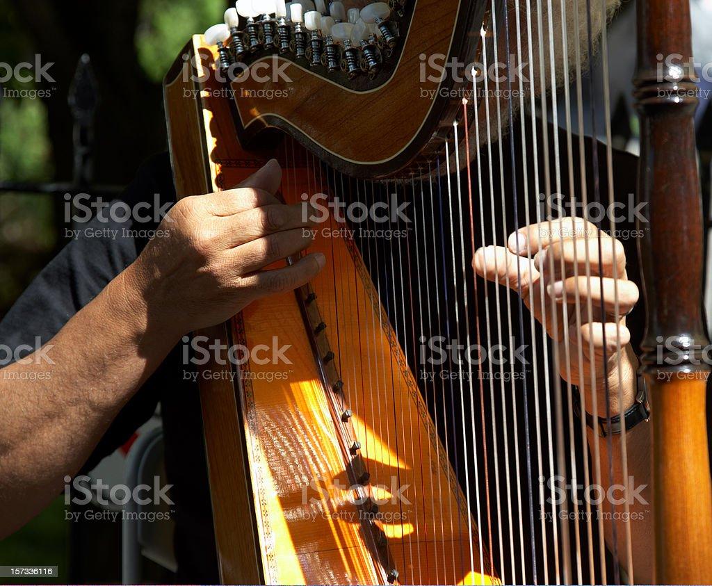 Harpist playing in sunshine royalty-free stock photo