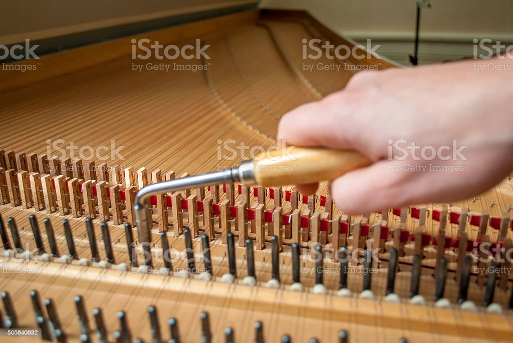 Harpsichord tuning the right tone ! stock photo