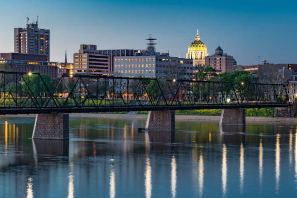 Harrisburg, Pennsylvania Night Skyline Harrisburg, Pennsylvania night skyline from the Market Street bridge with state capitol dome in the background. pennsylvania stock pictures, royalty-free photos & images