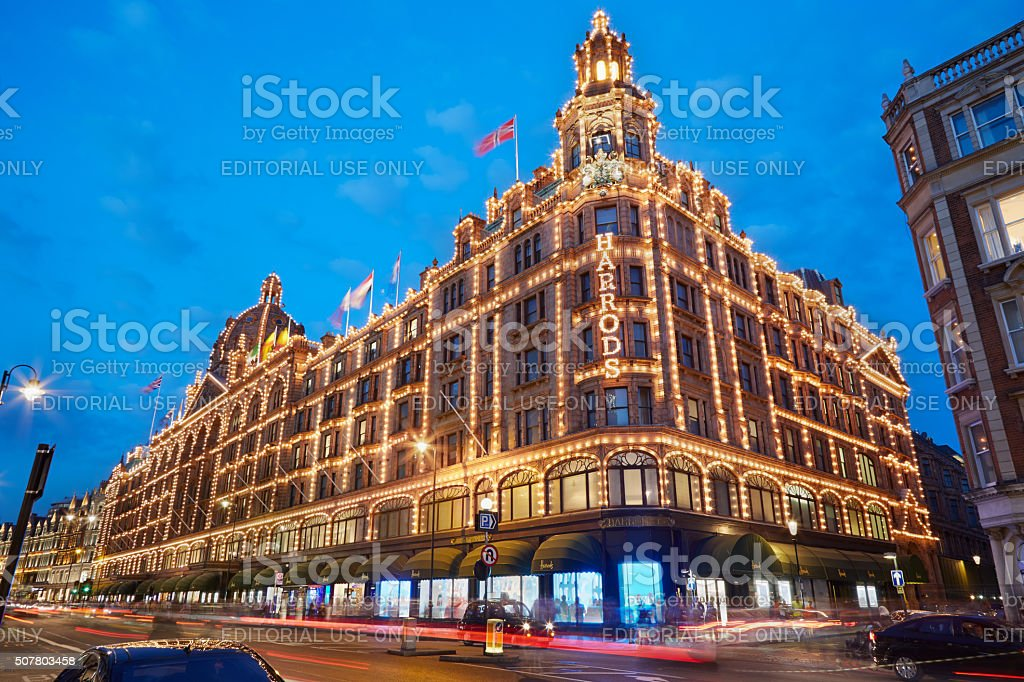 Harrods, luxury shopping in the evening in London stock photo
