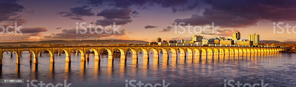 Harrsiburg, Pennsylvania skyline and railroad bridge stock photo