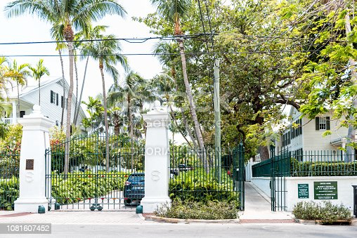 Key West, USA - May 1, 2018: Harry Truman little white house historic landmark on street architecture with tourist information sign in Florida city travel, sunny day